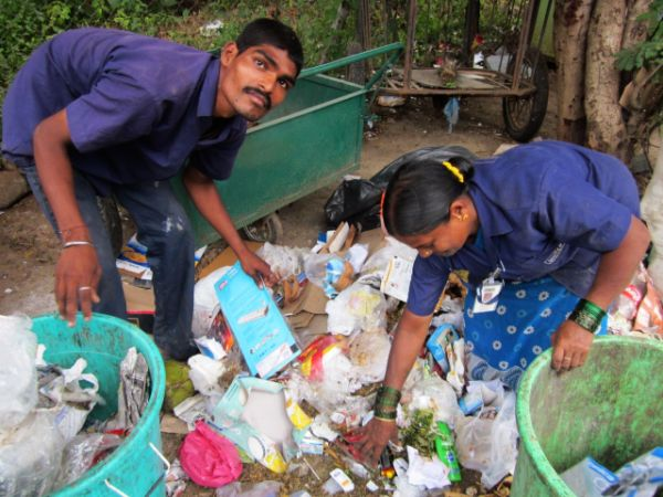 waste management in Indian - Swach Coop workers with uniform and id cards sort garbage