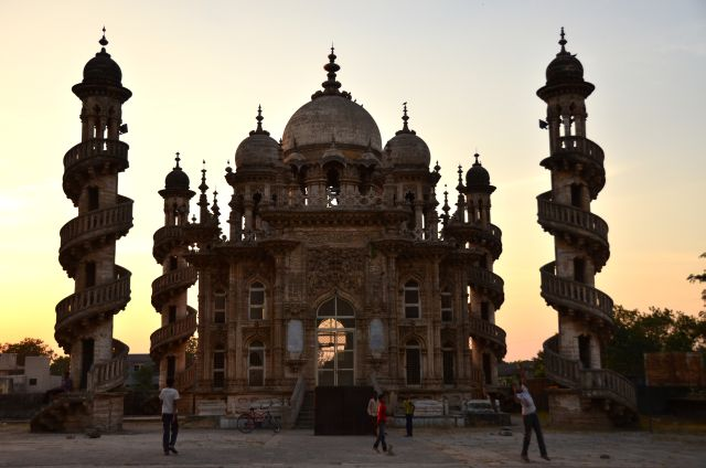 Junagadh - Children play cricket with the backdrop of the Mahabat Maqbara